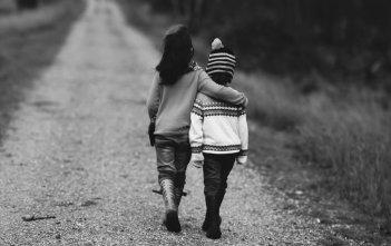 Children Walking on Road in Black & White