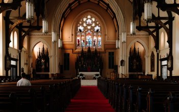 Person in a Church Praying
